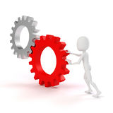 3d man- businessmen  pushing  two gear wheels Stock Image