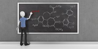 3d man with chemical formula on blackboard Stock Photo