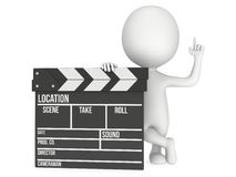 3D man with cinema clapperboard Royalty Free Stock Photos