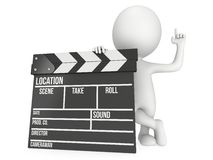 3D man with cinema clapperboard Stock Photography