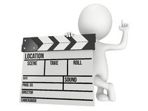 3D man with cinema clapperboard Royalty Free Stock Photo