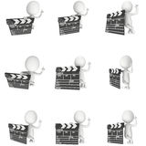 3D man with cinema clapperboard Stock Image
