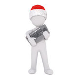 3d man clutching a new keyboard for Christmas. 3d man standing clutching a new computer keyboard for Christmas in a red Santa hat, isolated rendered illustration Royalty Free Stock Photography