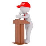 3D man in Donald Trump red cap. Figure of faceless 3D man character in red tie and Make America Great Again red cap standing at podium and gesturing isolated on Stock Images