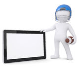 3d man in a football helmet holds tablet Royalty Free Stock Images