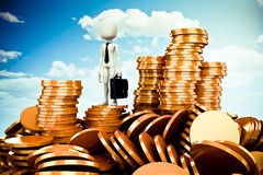 3d man and gold coins. 3d man and piles of gold coins Stock Image