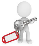 3D man holding silver key. 3D computer generated man holding silver key with chain and blank tag Stock Image