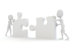 3d man joining two puzzle pieces. On white Stock Images