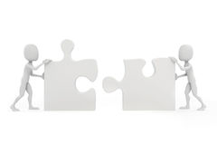 3d man joining two puzzle pieces. On white Stock Photos