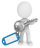 3D man with key. 3D computer generated man holding silver key with blue key chain Royalty Free Stock Photography