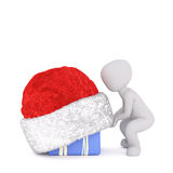 3d man lifting a Santa hat off an Xmas gift. Or covering it as a surprise for a loved one for Christmas, isolated 3d rendered cartoon illustration on white Stock Image