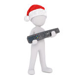 3d man in a red Santa hat holding a media remote. Control in his hands to celebrate the festive holiday season ,isolated rendered illustration on white Royalty Free Stock Photos