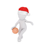 3d man in a Santa hat playing basketball Royalty Free Stock Photo