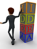 3d man standing with idea text in blocks concept Royalty Free Stock Photos