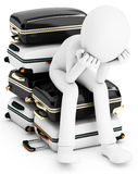 3d man thinking where to travel, sitting on a  pile of suitcases Stock Photo