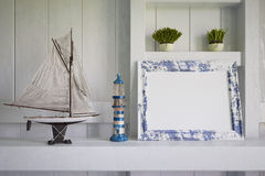 3d - maritime decoration - shot 01. 3d render of mock-up of a old picture frame - wooden background - maritime decoration Stock Photo