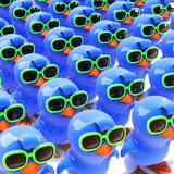 3d A mass of bluebirds wearing green sunglasses. 3d render of a crowd of bluebirds wearing green sunglasses Stock Images