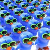 3d A mass of bluebirds wearing green sunglasses Stock Images