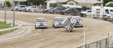 D-MAX Utes Performing Stunt. Four D-Max utes perform a stunt at the Mildura Show, (Australia) where the driver at the front balances on two side wheels Royalty Free Stock Image