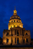 Dôme des Invalides in the evening. Cars standing for the red light on the Paris street with the dramatic sky on the background Stock Photo