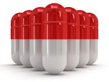 3d medical pills stand like pyramid on white Royalty Free Stock Photos
