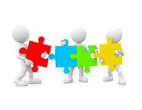 3D Men Holding Colourful Jigsaw Stock Images