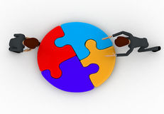 3d men joining colourful puzzles concept Royalty Free Stock Photos