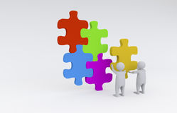 3d men with puzzle Stock Image