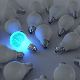 3d metal brain and growing light bulb. Standing out from the unlit incandescent bulbs as leadership concept Stock Image