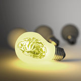 3d metal human brain in a light bulb Royalty Free Stock Photography