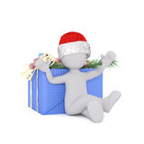3d model sitting at the christmas gift box. 3d model sitting in front at the christmas gift box and wearing a christmas hat Royalty Free Stock Image
