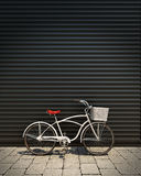 3d model of white retro bicycle with basket in front of the metal garage door, background. Urban concept Royalty Free Stock Images