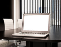 3D Modern meeting room with blank laptop screen. Mockup Royalty Free Stock Image
