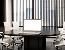 3D Modern meeting room with blank laptop screen. Mockup Stock Image