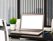 3D Modern office with blank laptop screen. Mockup Stock Photo