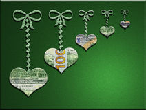 3-D money hearts hanging on bows w/ green background Royalty Free Stock Photos