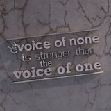 3D Motivational poster. The voice of none is stronger than the voice of one. 3D motivational poster.3D text on grungy wall Stock Photos