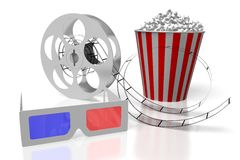 3D movies, cinema concept. 3D glasses, movie reel with film, popcorn - great for topics like movie theater/ cinema, watching films/ movies, entertainment etc Stock Images