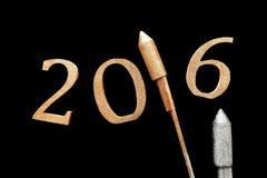 3D Nieuwjaar 2016 met Gouden en Zilveren Voetzoekers Stock Foto