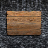 3D old wooden sign against a grunge brick wall. 3D render of an old wooden sign against a grunge brick wall Stock Photography