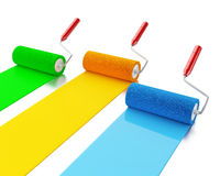 3d Paint rollers with colours blue, green and yellow. Royalty Free Stock Photography