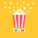 3D paper red blue glasses and big popping popcorn box. Cinema movie night icon in flat design style. Yellow background. Royalty Free Stock Photo
