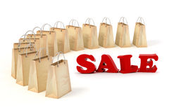 3d paper shopping bags and big red SALE text. On white background Stock Photos