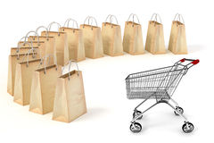 3d paper shopping bags and a shopping cart Stock Photography