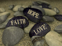 3d pebble on sand message love faith hope Stock Photo