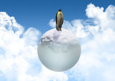 3D penguin on an icy globe Stock Photography