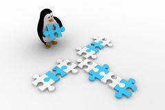 3d penguin making cross path using blue and white puzzle piece concept Stock Image
