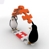 3d penguin making roof from pieces of jigsaw puzzle concept Royalty Free Stock Images