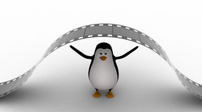 3d penguin under big and long film reel concept Stock Images