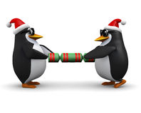 3d Penguins pulling a Christmas cracker Royalty Free Stock Photos